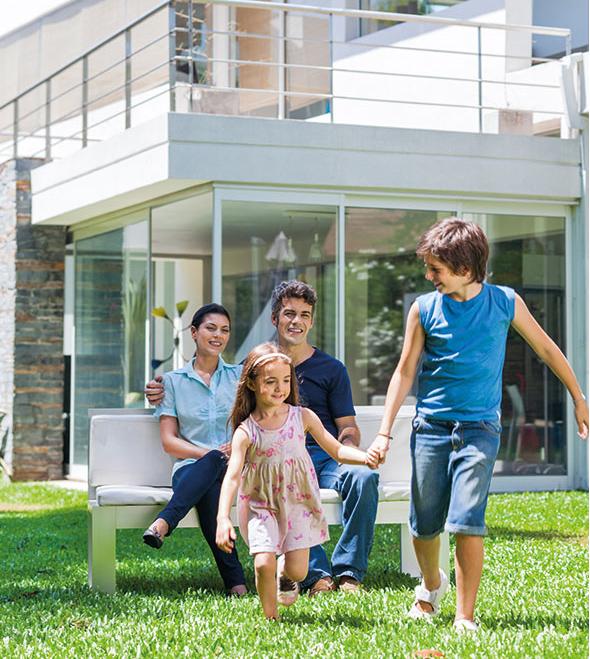 Young family outisde modern Oakville home