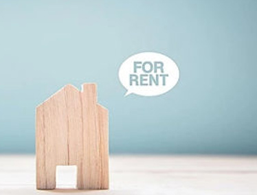 """Miniature wooden home with """"for rent"""" speech bubble"""