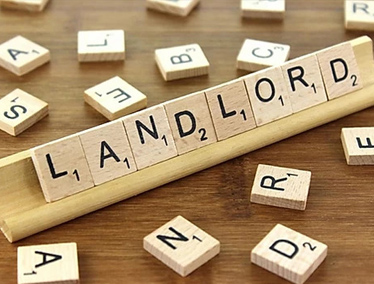 """Wooden tiles spelling out """"Landlord"""""""