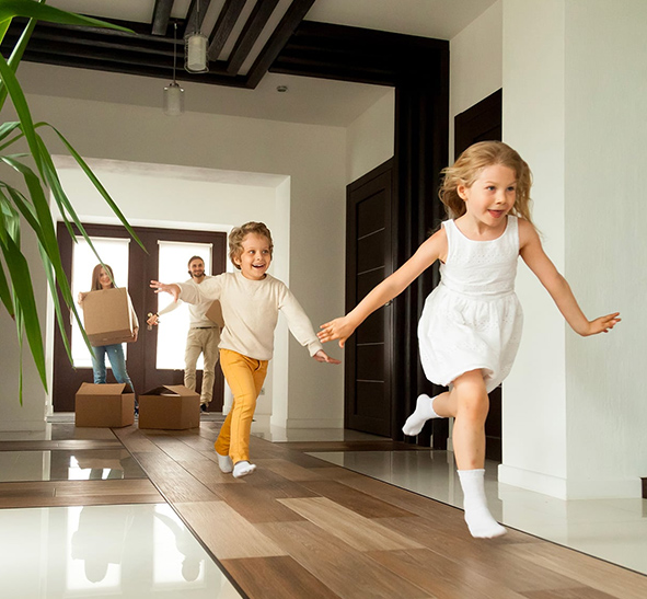 Children running in hallway of substantially renovated home