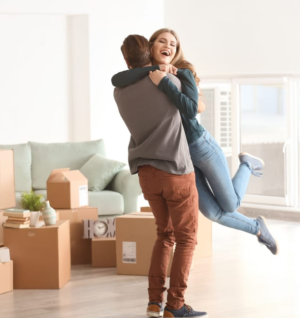 Young couple embracing in renovated Oakville living room
