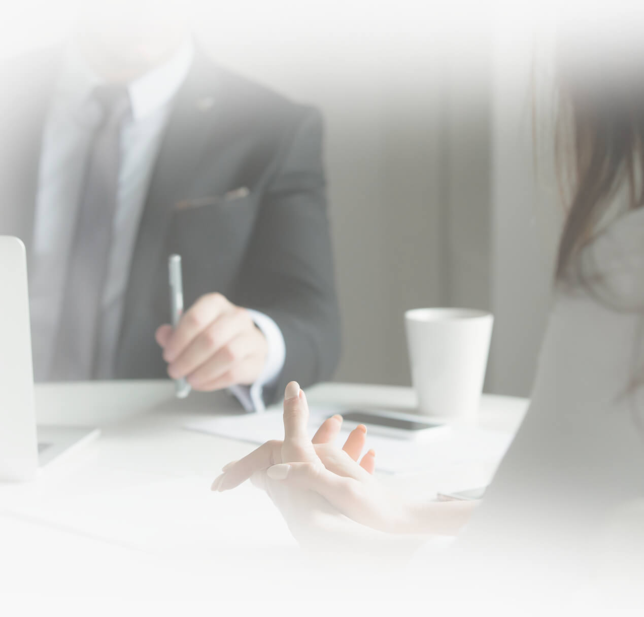 Tax expert sitting at desk with client