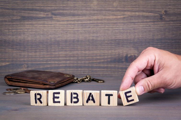 """Placing wooden blocks spelling the word """"Rebate"""""""