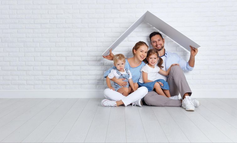 New family smiling while pretending to play house