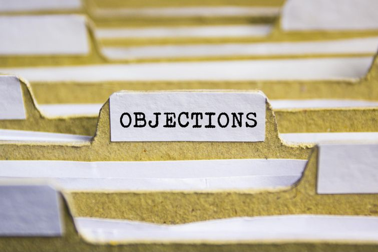 File folder holding Notices Of Objection for denied HST rebate